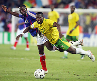 France's Claude Makelele (6) colides with Togo's Kader Mohamed (17). France defeated Togo 2-0 in their FIFA World Cup Group G match at FIFA World Cup Stadium, Cologne, Germany, June 23, 2006.