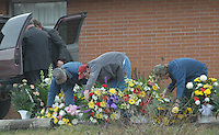 Pallbearers arrange flowers outside the funeral home for the funeral for Sago miner Jesse Jones Sunday, Jan. 8, 2006, in Buckhannon, WV Jones is one of 12 miners killed in the Sago mine explosion (Gary Gardiner/EyePush Newsphotos)<br />