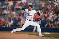 Kannapolis Cannon Ballers pitcher Jesus Valles (14) in action against the Charleston RiverDogs at Atrium Health Ballpark on July 4, 2021 in Kannapolis, North Carolina. (Brian Westerholt/Four Seam Images)