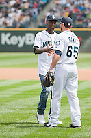 Seattle, WA - Sunday, June 10, 2013: Eddie Johnson throws out the first pitch at the Mariners game with Clint Dempsey and Tim Howard.
