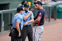 Home plate umpire Joe Belangia and field umpire Dylan Bradley check Rome pitcher A.J. Puckett (20) for foreign substances during a game between the Rome Braves and the Greenville Drive on Sunday, August 8, 2021, at Fluor Field at the West End in Greenville, South Carolina. (Tom Priddy/Four Seam Images)