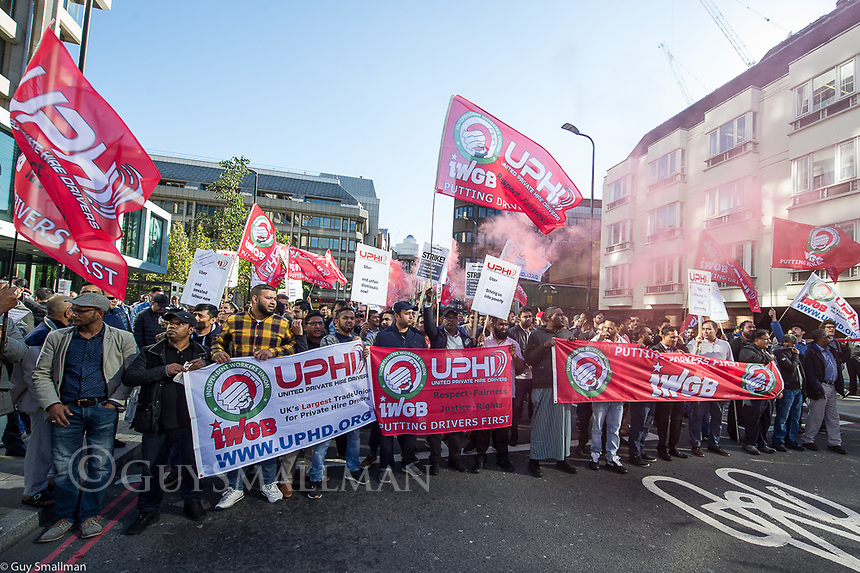 Uber drivers go on strike in London demanding better pay and conditions. Members of the Unite Private Hire Drivers branch of the IWGB trade union protest outside the Uber HQ in East London and then march around the surrounding area blocking several major roads. East London. 9-10-18
