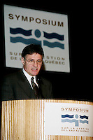 Montreal (Qc) CANADA - December 12, 1997<br /> -File Photo -<br /> Paul Begin, quebec environment Minister speak at Sympeau - symposium sur l'eau held at Montreal Convention Centre.<br /> <br /> <br /> Paul Begin (born May 15, 1943 in Dolbeau, Quebec) is a former Quebec politician and Cabinet Minister. Member of the Parti Québecois, he served as the province's Justice Minister from 1994 to 1997 and from 2001 to 2002. Louis-Hébert riding in the 1994 elections when the Parti Québecois re-claimed power after 9 years of Liberal governance under Robert Bourassa and Daniel Johnson Jr.. During his political career, he was also a member of Cabinet, being first named for the first time as Justice Minister in the Jacques Parizeau (and later Lucien Bouchard)Cabinet from 1994 to 1997. He was also the Environment Minister from 1997 to 2001, Minister of Wildlife from 1997 to 1998 and Minister of Revenue from 1999 to 2001 before being re-named as Justice Minister in the Bernard Landry Cabinet for his final year until he sat as an Independent MNA in 2002. He did not seek a third mandate in the 2003 elections.