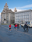 A view of the Pier Head in Liverpool with the Liver builtding in the background