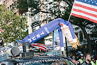 A blow-up figure of Trump is seen on the vehicle pulling the Trump Unity Bridge in the Straight Pride Parade in Boston, Massachusetts, on Sat., August 31, 2019. The parade was organized in reaction to LGBTQ Pride month activities by an organization called Super Happy Fun America.