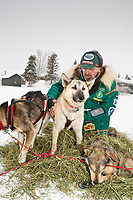 Veterinarian Jerry Vanek checks a Paul Gebhart dog  on Puntilla Lake at the Rainy Pass checkpoint in Southcentral Alaska during the 2010 Iditarod