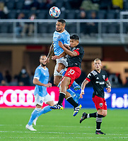 WASHINGTON, DC - APRIL 17: Alexander Callen #6 of New York City FC goes up for a header with Edison Flores #10 of D.C. United during a game between New York City FC and D.C. United at Audi Field on April 17, 2021 in Washington, DC.