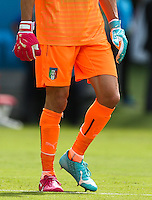 Italy goalkeeper Gianluigi Buffon wears odd coloured Puma goalkeeping gloves and boots