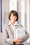 Portrait of businesswoman with files
