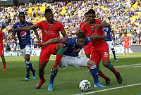 BOGOTÁ- COLOMBIA,06-10-2019:Cristian Arango (Centro.) jugador de Millonarios disputa el balón con Cesar Hinestroza  (Izq.) y Martin Payares (Der.)jugadores de Patriotas Boyacá durante partido por la fecha 15 de la Liga Águila II 2019 jugado en el estadio Nemesio Camacho El Campín de la ciudad de Bogotá. /Cristian Arango (C) player of Millonarios fights the ball  against of Cesar Hinestroza (L) and Martin Payares (R)player of Patriotas Boyaca during the  match for the date 15 of the Liga Aguila II 2019 played at the Nemesio Camacho El Campin stadium in Bogota city. Photo: VizzorImage / Felipe Caicedo / Staff