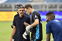 KANSAS CITY, KS - SEPTEMBER 02: Kyle Zobeck #30 of FC Dallas gets instructions from Luchi Gonzalez Head Coach of FC Dallas prior to coming into the game as a sub during a game between FC Dallas and Sporting Kansas City at Children's Mercy Park on September 02, 2020 in Kansas City, Kansas.