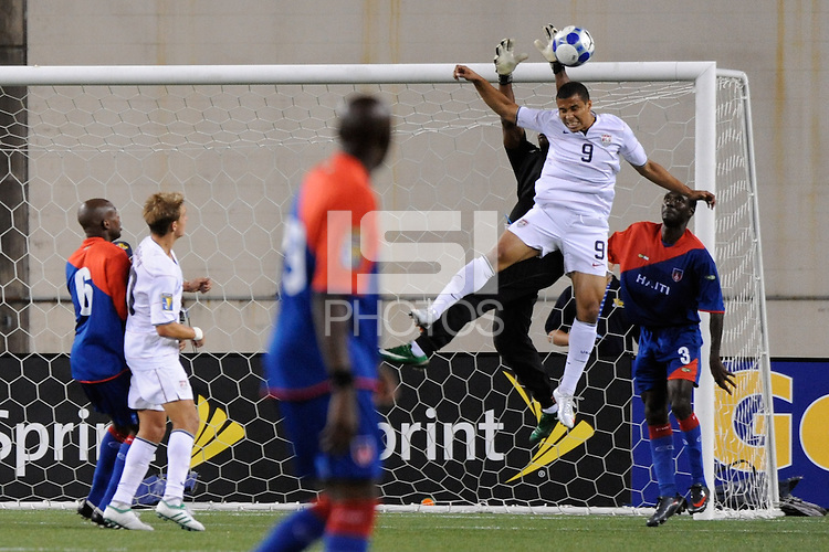 Charlie Davies (9) of the United States (USA) battles Haiti (HAI) goalkeeper Jean Dominique Zerphirin (18) for the ball. The United States and Haiti played to a 2-2 tie during a CONCACAF Gold Cup Group B group stage match at Gillette Stadium in Foxborough, MA, on July 11, 2009. .