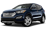 Low aggressive front three quarter view of a 2013 Hyundai Santa Fe Sport