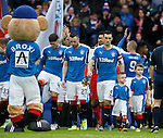 Lee Wallace leads out the mascots