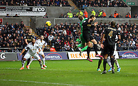 Wednesday, 01 January 2014<br /> Pictured: Ashley Williams of Swansea (2nd L) fails to score with a header from a cross, after Joe Hart, Manchester City goalkeeper (in green) fails to save the ball.<br /> Re: Barclay's Premier League, Swansea City FC v Manchester City at the Liberty Stadium, south Wales.
