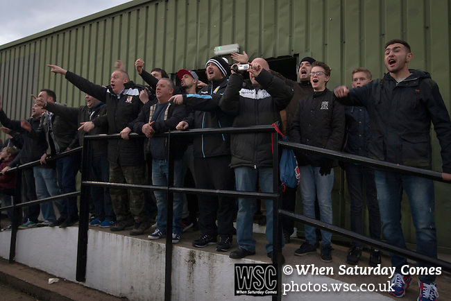 Stafford Rangers 2 Chasetown 1, 26/12/2015. Marston Road, Northern Premier League. Home supporters watching the first-half action at the social club end of Marston Road, home of Stafford Rangers as they took on local rivals Chasetown in a Northern Premier League first division south fixture. The club has played at Marston Road since 1896 and achieved prominence in the 1970s and 1980s as one of England's top non-League teams. League leaders Stafford won this match 2-1, despite having a man sent off, watched by a season's best attendance of 978. Photo by Colin McPherson.
