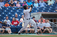 Heriberto Hernandez (11) of the Charleston RiverDogs follows through on his swing against the Kannapolis Cannon Ballers at Atrium Health Ballpark on July 1, 2021 in Kannapolis, North Carolina. (Brian Westerholt/Four Seam Images)