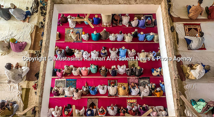 Friday prayer service has returned to normality at a Bangladeshi mosque.  Around 3,000 people attended the incredible three-storey high building for their weekly prayers.<br /> <br /> Some of the worshippers wore masks but apart from that the service appeared to be back to a pre-pandemic routine.  The images were captured by engineer and amateur photographer Mustasinur Rahman Alvi at the Muslim Gorosthan Jame Mosque in Barisal Town, Bangladesh.  SEE OUR COPY FOR DETAILS.<br /> <br /> Please byline: Mustasinur Rahman Alvi/Solent News<br /> <br /> © Mustasinur Rahman Alvi/Solent News & Photo Agency<br /> UK +44 (0) 2380 458800