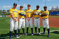Michigan Wolverines Jonathan Engelmann (2), Hector Gutierrez (24), Matthew Schmidt (9), Christan Bullock (5), and Ako Thomas (4) before a game against Army West Point on February 17, 2018 at Tradition Field in St. Lucie, Florida.  Army defeated Michigan 4-3.  (Mike Janes/Four Seam Images)