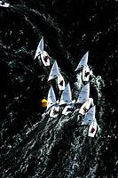 """Kieler Woche:EUROPA, DEUTSCHLAND, SCHLESWIG- HOLSTEIN 22.06.2005:Kieler Woche, Segler der Laser Klasse im Gedraenge an der Wende. <br /><br />Der Laser ist eine 4,23 m lange, 1,37 m breite und 57 kg (Rumpf) schwere Einmann-Jolle mit einem Segel.<br /><br />Der Laser wurde 1970 vom Amerikaner Bruce Kirby als Einhand-Jolle entworfen. Primaere Zielsetzung war damals ein Boot für die Freizeit zu entwerfen, deshalb auch der ursprüngliche Name """"Freetime"""".<br />Seine einfache Bauweise und niedrige Anschaffungskosten führten zu einer raschen Ausbreitung. Ende des Jahres 2004 gab es ca. 180.000 Boote auf der Welt!<br />Der Laser ist eine One-Design Bootsklasse und wird von der Firma Performance Sailcraft Ltd. in England gefertigt. Weiterhin gibt es Lizenznehmer in Australien und in Chile.<br />Das Niveau in der Laser-Klasse gilt als eines der höchsten der olympischen Bootsklassen<br /><br />Luftaufnahme, Luftbild,  Luftansicht"""