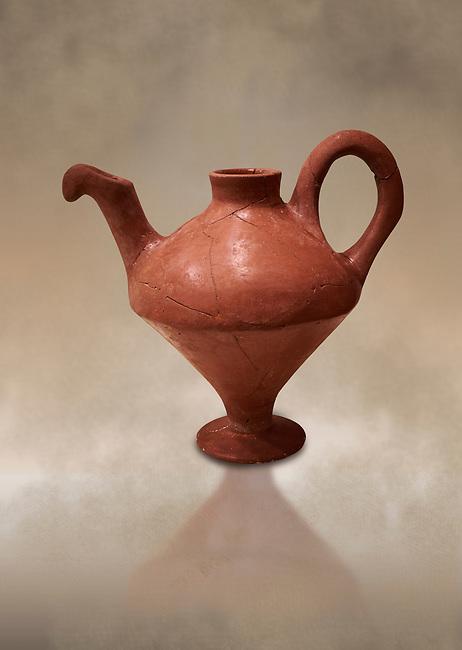Hittite terra cotta side spouted teapot . Hittite Period, 1600 - 1200 BC.  Hattusa Boğazkale. Çorum Archaeological Museum, Corum, Turkey. Against a warm art bacground.
