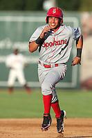Spokane Indians infielder Edwin Garcia #1 runs the bases against the Salem-Keizer Volcanoes at Volcanoes Stadium on August 10, 2011 in Salem-Keizer,Oregon. Salem-Keizer defeated Spokane 7-6.(Larry Goren/Four Seam Images)