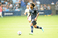 KANSAS CITY, KS - JUNE 26: Gianluca Busio #10 Sporting KC with the ball during a game between Los Angeles FC and Sporting Kansas City at Children's Mercy Park on June 26, 2021 in Kansas City, Kansas.