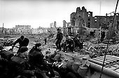 Grozny, Chechyna.1995.Russian Interior Ministry troops sit atop their APCs in the center of Grozny as teams of demolition experts explode massive amounts of unspent ammunition found in the buildings..