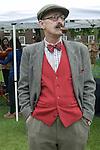The Tweed Run London UK. Tea Stop. Man smoking pipe.