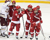 Michael Mersch (Wisconsin - 25), Morgan Zulinick (Wisconsin - 15), Nic Kerdiles (Wisconsin - 17), Joe Faust (Wisconsin - 24), Kevin Schulze (Wisconsin - 28) - The Boston College Eagles defeated the visiting University of Wisconsin Badgers 9-2 on Friday, October 18, 2013, at Kelley Rink in Conte Forum in Chestnut Hill, Massachusetts.