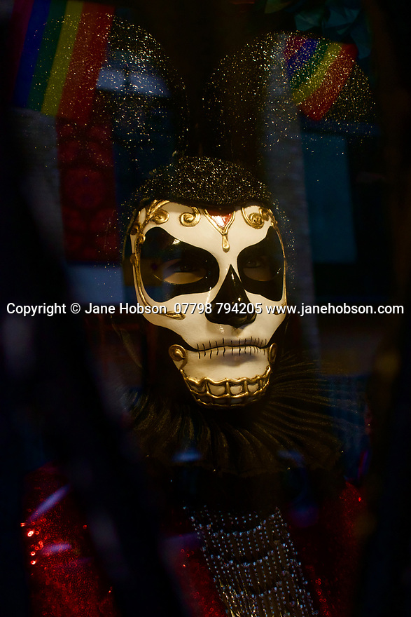 London, UK. 02.02.2020. Day of the Dead mask, in the window of a fabric shop, Berwick Street, Soho, London, UK. Photograph © Jane Hobson.