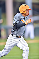 Tennessee Volunteers catcher Benito Santiago (31) runs to first base during a game against the University of North Carolina Greensboro (UNCG) Spartans at Lindsey Nelson Stadium on February 24, 2018 in Knoxville, Tennessee. The Volunteers defeated Spartans 11-4. (Tony Farlow/Four Seam Images)