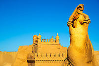 Large, beautiful sand sculpture representing Spain of a woman dancing flamenco under a southern Portugal blue sky in Algarve