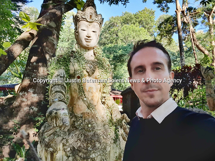 Pictured: Justin Bateman in Thailand<br /> <br /> A British artist stuck in Thailand has spent his time constructing masterpieces from pebbles for locals to enjoy.  Justin Bateman had only planned on staying in Chiang Mai for a week - but has remained there now for nearly ten months after the pandemic struck. <br /> <br /> His pebble portraits include The Queen, Spanish painter Pablo Picasso, Michelangelo's David and a local farmer - who was bemused by his portrait.   Mr Bateman, from Portsmouth, Hants, was staying in Bali when he travelled to Chiang Mai, in Thailand, to visit some friends.   SEE OUR COPY FOR DETAILS.<br /> <br /> Please byline: Justin Bateman/Solent News<br /> <br /> © Justin Bateman/Solent News & Photo Agency<br /> UK +44 (0) 2380 458800