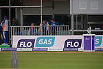 The match trophy at right with England players at left at the Ireland v England One Day Cricket International held at Malahide Cricket Club, Dublin, Ireland. 8th May 2015.<br /> Photo: Joe Curtis/www.newsfile.ie
