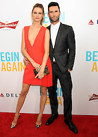 """NEW YORK CITY, NY, USA - JUNE 25: Model Behati Prinsloo and Musician Adam Levine arrive at the New York Premiere Of The Weinstein Company's """"Begin Again"""" held at the SVA Theatre on June 25, 2014 in New York City, New York, United States. (Photo by Celebrity Monitor)"""