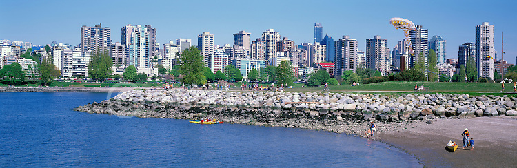 "City of Vancouver Skyline and Downtown ""West End"" from Vanier Park and English Bay at False Creek, BC, British Columbia, Canada, in Spring.  Many spring and summer activities are taking place in this photo - Beach Exploring, Canoeing, Cycling, Kayaking, Kite Flying, Relaxing, and Walking. - Panoramic View"