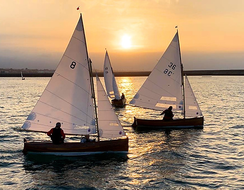 The sun sets on 2020 club racing…..with the next lockdown imminent, the Water Wags see the sun set on Tim Pearson winning from Ian Malcolm, with Martin Byrne coming in on port tack.  Photo: Cathy Mac Aleavey
