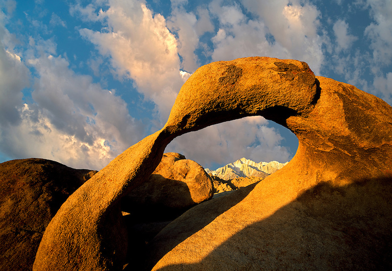 Arch and Lone Pine Peak framed with moon. Alabama Hills, California