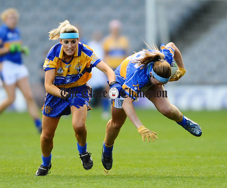 Tipperary's Angie Mc Dermott is tackled by Clare's Michele Delaney during the Intermediate Ladies Football final at Croke Park. Photograph by John Kelly.