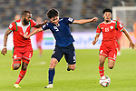 Minamino Takumi of Japan (C) fights for the ball with Saad Al Mukhaini of Oman (L) during the AFC Asian Cup UAE 2019 Group F match between Oman (OMA) and Japan (JPN) at Zayed Sports City Stadium on 13 January 2019 in Abu Dhabi, United Arab Emirates. Photo by Marcio Rodrigo Machado / Power Sport Images