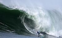 "Half Moon Bay, California - January 24, 2014: 2014 Maverick's Invitational Champion Grant ""Twiggy"" Baker with a bottom turn."
