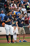 Reno Aces' Carlso Rivero and fans listen to the National Anthem before a game at Greater Nevada Field in Reno, Nev., on Sunday, July 17, 2016.<br />
