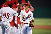 Auburn Doubledays center fielder Ricardo Mendez (17) celebrates with his teammates after a game against the Batavia Muckdogs on June 15, 2018 at Falcon Park in Auburn, New York.  Auburn defeated Batavia 5-1.  (Mike Janes/Four Seam Images)