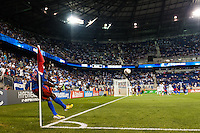 Haiti defender Olrish Saurel (20) takes a corner kick. Honduras defeated Haiti 2-0 during a CONCACAF Gold Cup group B match at Red Bull Arena in Harrison, NJ, on July 8, 2013.