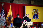 As Republican Presidential candidate Donald Trump is about to step of the stage after delivering a speech he is tapped on the shoulder by former candidate Gov. Chris Christie at a May 19th, 2016 fundraising evening in Lawrenceville, NJ.