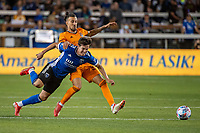SAN JOSE, CA - JULY 24: Carlos Fierro #7 of the San Jose Earthquakes is tackled by Maximiliano Urruti #37 of the Houston Dynamo during a game between San Jose Earthquakes and Houston Dynamo at PayPal Park on July 24, 2021 in San Jose, California.