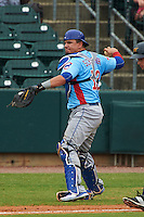 Tennessee Smokies catcher Kyle Schwarber (12) throws to first to complete the strike out during a game against the Montgomery Biscuits on May 25, 2015 at Riverwalk Stadium in Montgomery, Alabama.  Tennessee defeated Montgomery 6-3 as the game was called after eight innings due to rain.  (Mike Janes/Four Seam Images)