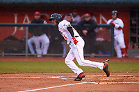 Lansing Lugnuts Reggie Pruitt (5) runs to first base during a Midwest League game against the Wisconsin Timber Rattlers at Cooley Law School Stadium on May 2, 2019 in Lansing, Michigan. Lansing defeated Wisconsin 10-4. (Zachary Lucy/Four Seam Images)