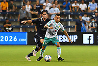 KANSAS CITY, KS - AUGUST 10: Jean Meneses #16 of Club Leon FC shields the ball away from Grayson Barber #19 of Sporting Kansas City during a game between Club Leon FC and Sporting KC at Children's Mercy Park on August 10, 2021 in Kansas City, Kansas.